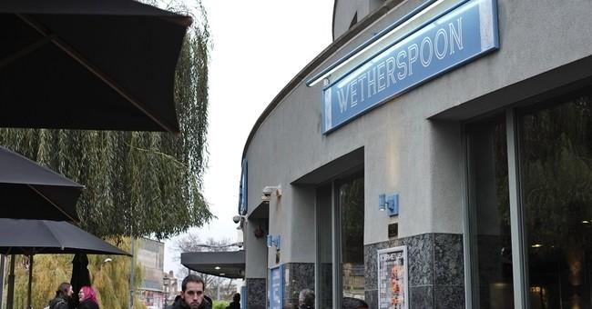 UK pub chain, Heineken clash over beer cost