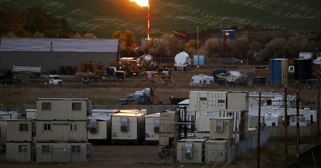 Exxon sees abundant oil, gas far into future