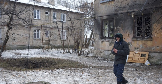 Ukraine forces, rebels largely suspend hostilities