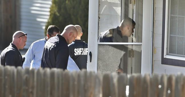 1 man arrested, 1 at large after 3 killed near Denver