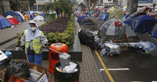 Hong Kong police start clearing main protest camp