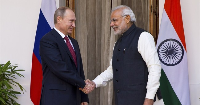 Putin turns to India to clinch new deals