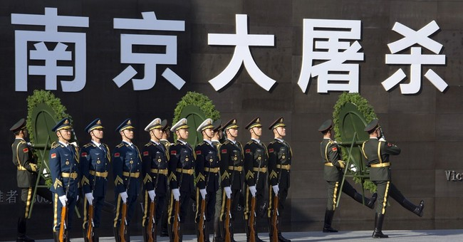 China leaders preside at WWII massacre remembrance