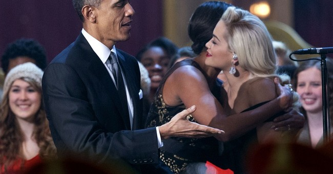 Obamas get into holiday spirit at benefit concert