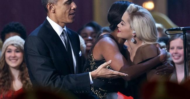 Obamas get into holiday spirit at benefit concert