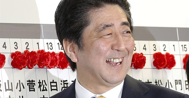 Japan's Abe faces battle on reforms despite win