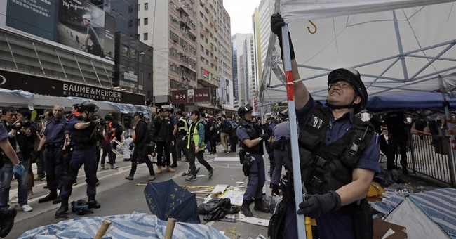 Hong Kong police close last protest site, arrest protesters