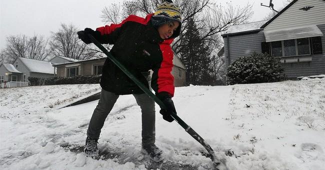 Freezing rain coats roads in the Dakotas, hampering travel
