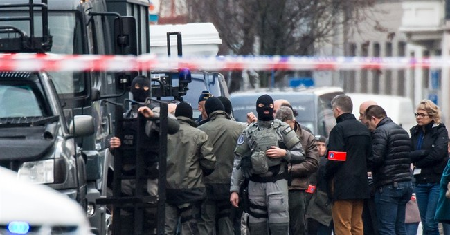 Belgian police detain 3 after apartment siege