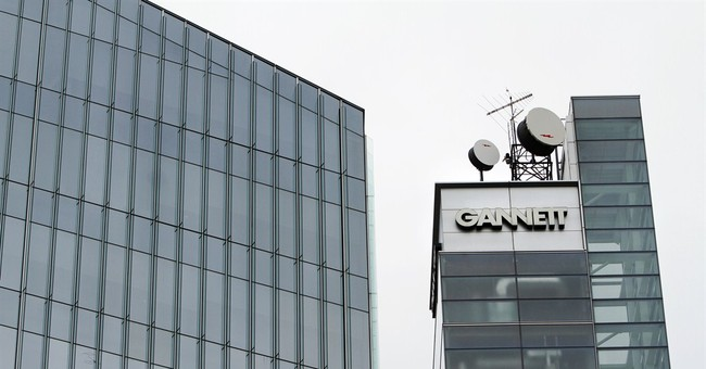 Gannett 4Q profit down 12 pct on lower ad spending