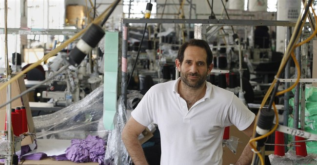 American Apparel fires founder Charney, names new CEO