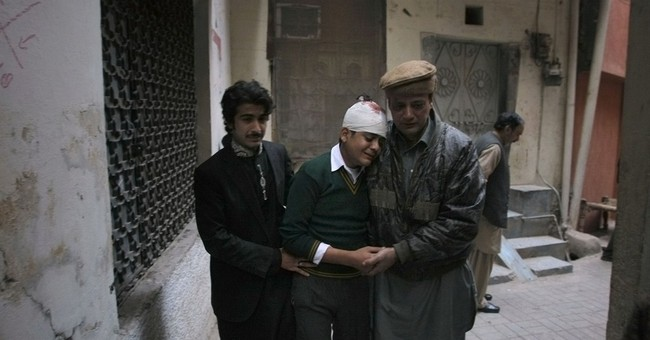 141 _ mostly children _ killed in Pakistan attack