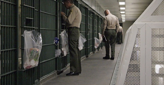 LA sheriff agrees to oversight of jails to settle abuse suit