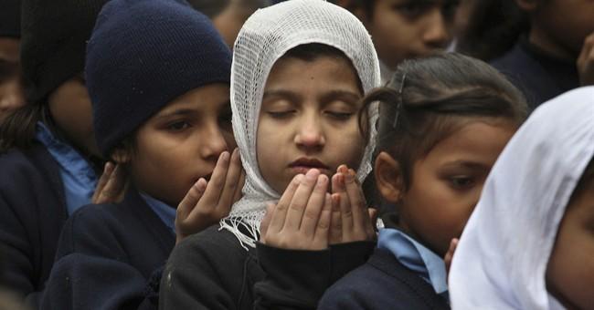 Pakistan buries victims of school massacre