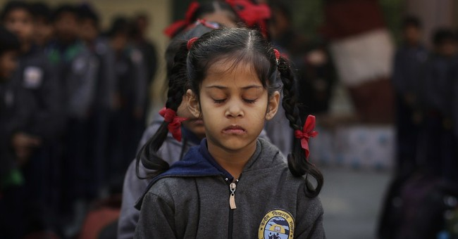 Image of Asia: Indians pray for Pakistan victims