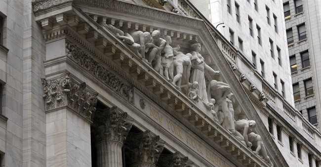 US stocks open higher; Traders watch Fed meeting