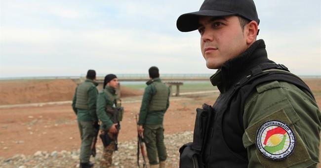 Iraqi Kurdish troops battling IS open key corridor in Iraq