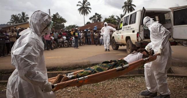 Sierra Leone urges safe burials to stem Ebola
