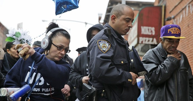 Obama offers help to NYPD after 2 officers killed