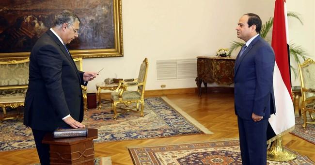 Egypt President awards medal to retired spy chief