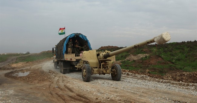 Iraqi Kurds push into contested northern town