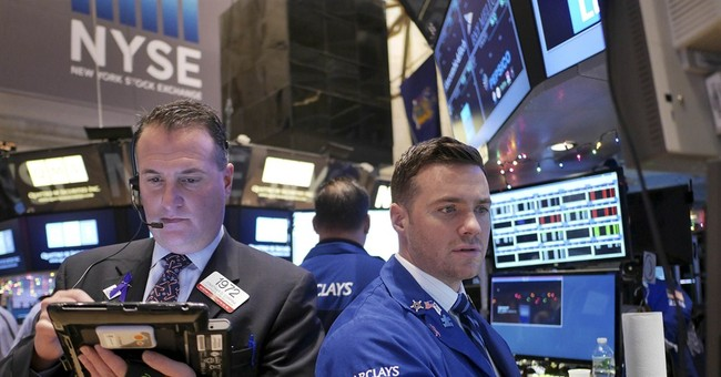 Dow tops 18,000 as market reaches new highs