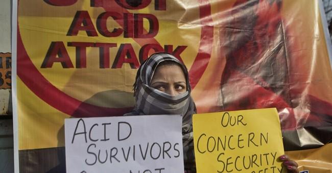 2 men throw acid on woman in Indian capital