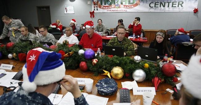 NORAD volunteers warn kids to be asleep for Santa visit