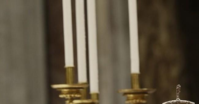 Pope celebrates Christmas Eve Mass and calls Iraqi refugees