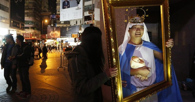 AP PHOTOS: Lights and smiles mark the coming of Christmas