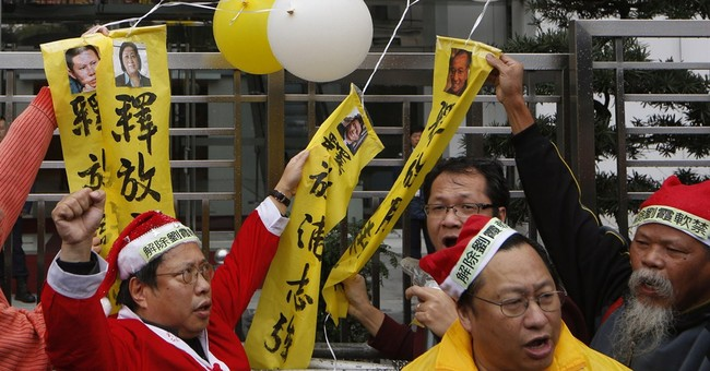 Hong Kong police arrest 12 democracy protesters