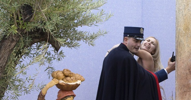 Woman who bared breasts in Vatican square is freed