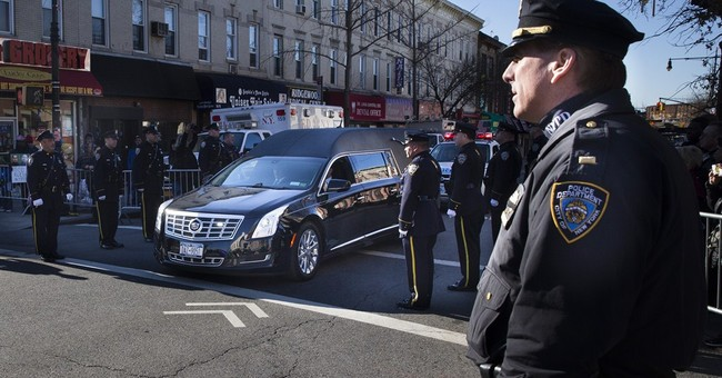 Thousands attend 8-hour wake for slain NYC officer