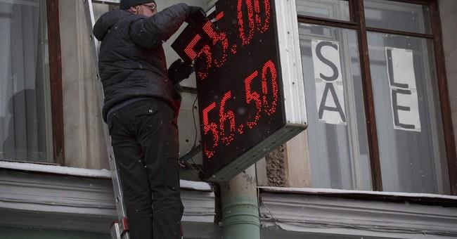 Russian ruble drops 7 percent as economy shrinks