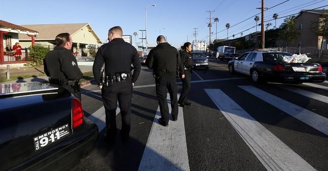 2 men open fire on Los Angeles police patrol car