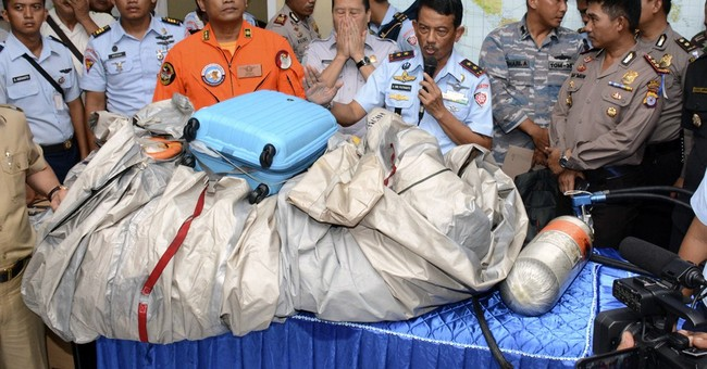 Wreckage, bodies might hold clues in AirAsia crash