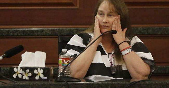 Killer's wife pleads guilty in Texas DA murder case
