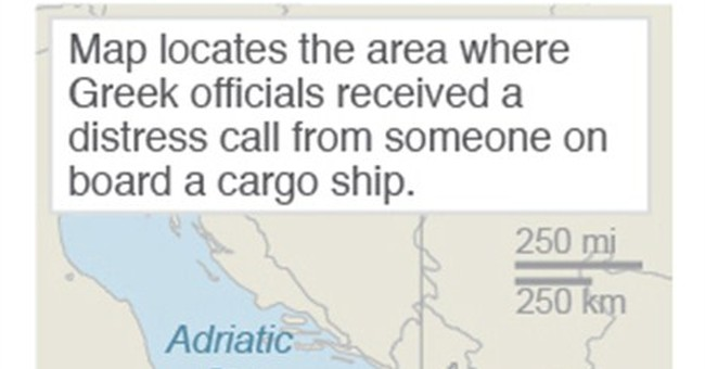 Italy takes control of migrant ship on collision course
