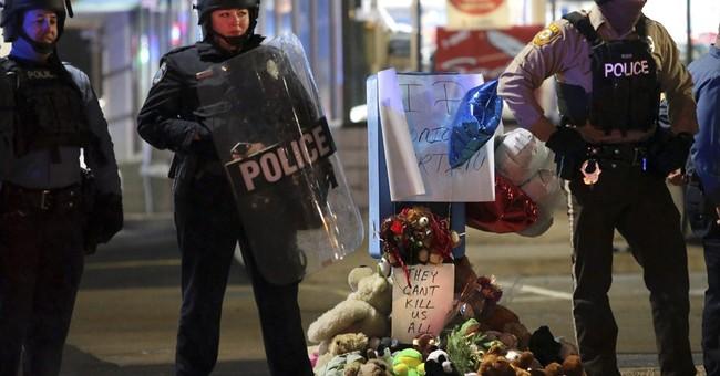 Chief: Probe shows man shot by officer had gun