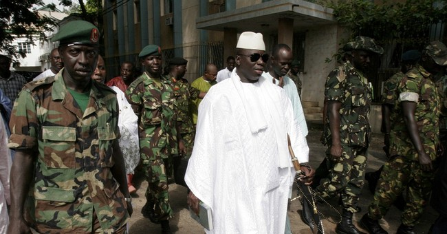 Gunfire reported in Gambian capital as president away