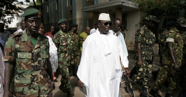 Gunfire reported in Gambian capital as president away
