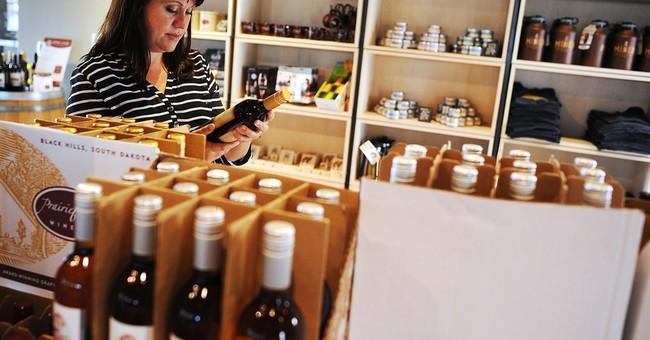 New laws OK wine shipments, ban tiger selfies