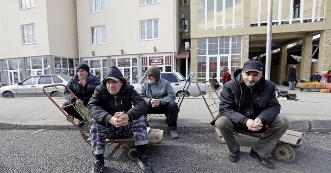 Along the border near Sochi, a ring of steel rises