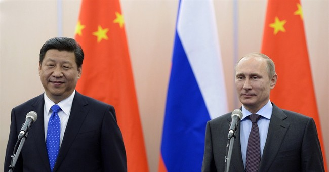 In Putin meeting, China's Xi praises Russia ties