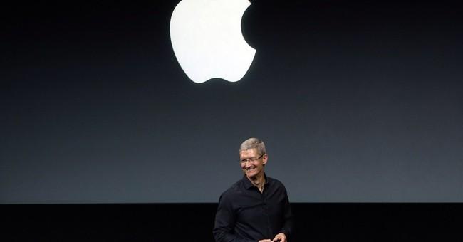 Apple takes $14B bite of its stock via buyback