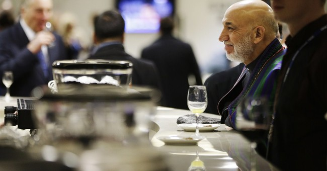 SOCHI SCENE: Thoughtful Karzai