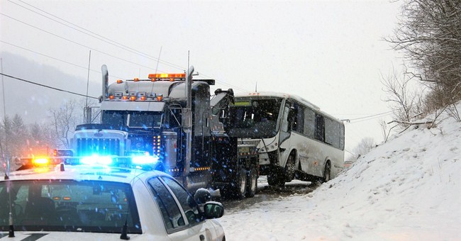 Bus crash on snowy Pa. road injures more than 20