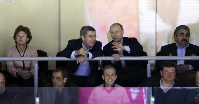 SOCHI SCENE: Putin catches some hockey