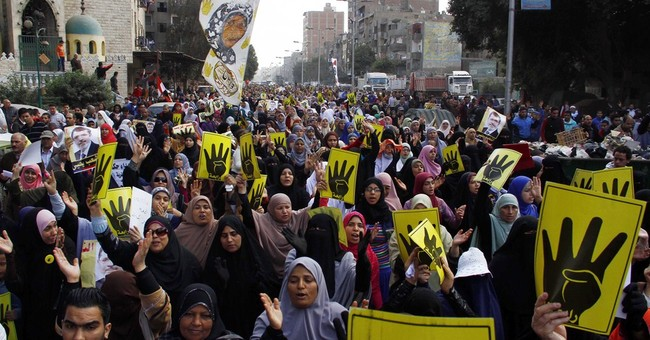 Ousted Egypt leader's lawyers protest court cage