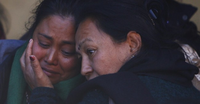 Nepal plane crash kills 18 in snow, rain and fog